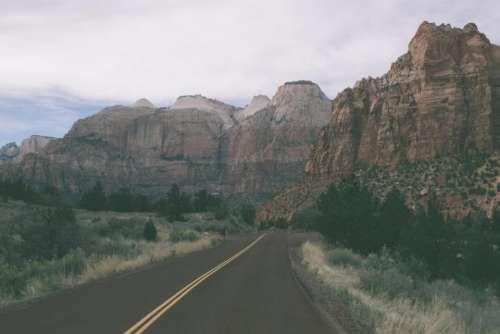 rural road canyons cliffs landscape
