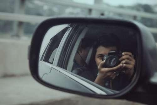 car mirror camera travel person