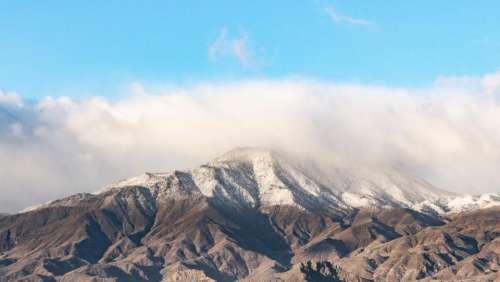 mountain highland cloudy sky ridge