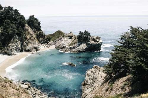 mountain hill rocks coast water