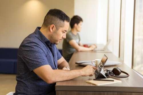 man working ipad tablet techonology