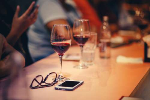 glass red wine table spectacles mobile device