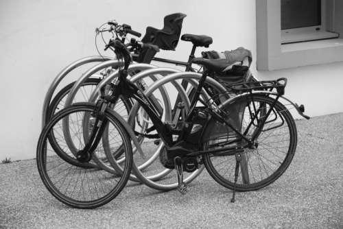 bike bicycle black and white tire sidewalk
