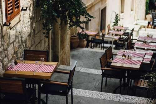 tables chairs restaurants cutlery setup