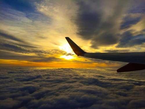airplane travel trip flight clouds