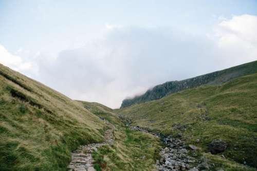 green grass highland mountain rocks
