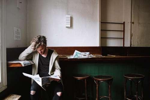thinking people man reading magazine