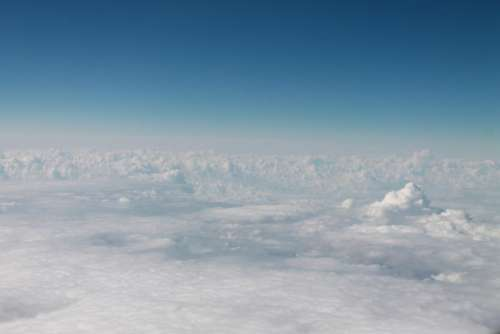 above the clouds sky white airplane blue
