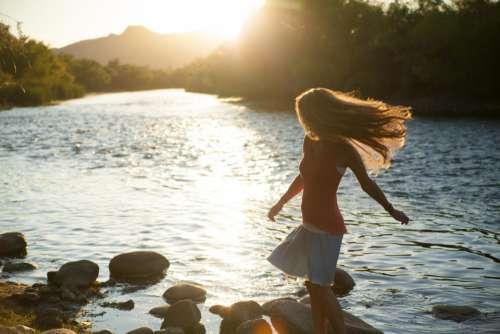 sunset girl river cross sunny
