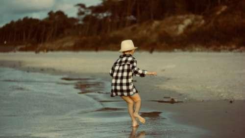 child playing beach boy male