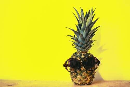 pineapple sunglasses yellow background minimal
