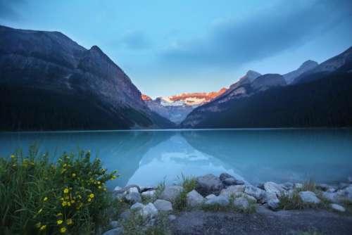 lake river water mountains peaks