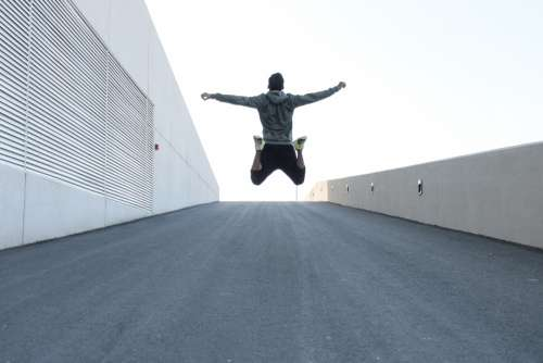 man jumping road healthy fit