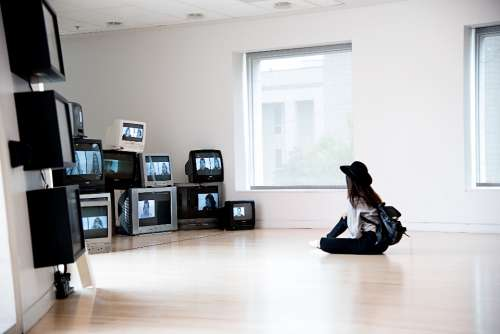 woman watching television multiple old