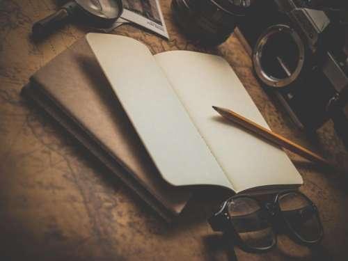 notepad notebook pencil eyeglasses camera