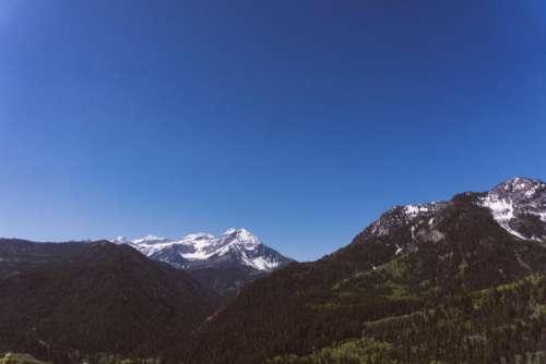 blue sky mountain highland trees