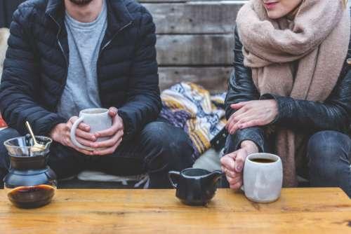 drinking coffee outside man woman