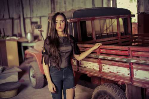 young woman vintage truck transport