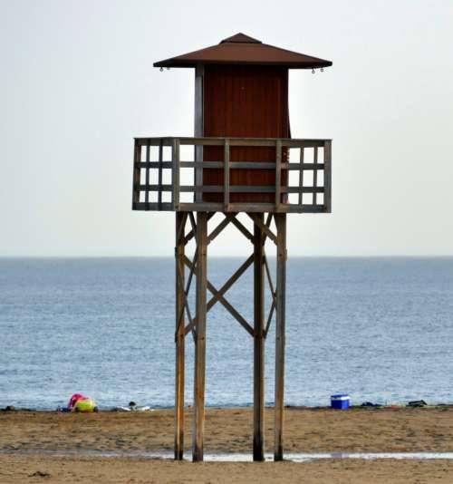 beach lifeguard tower ocean water