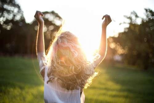 woman sunshine happy field park