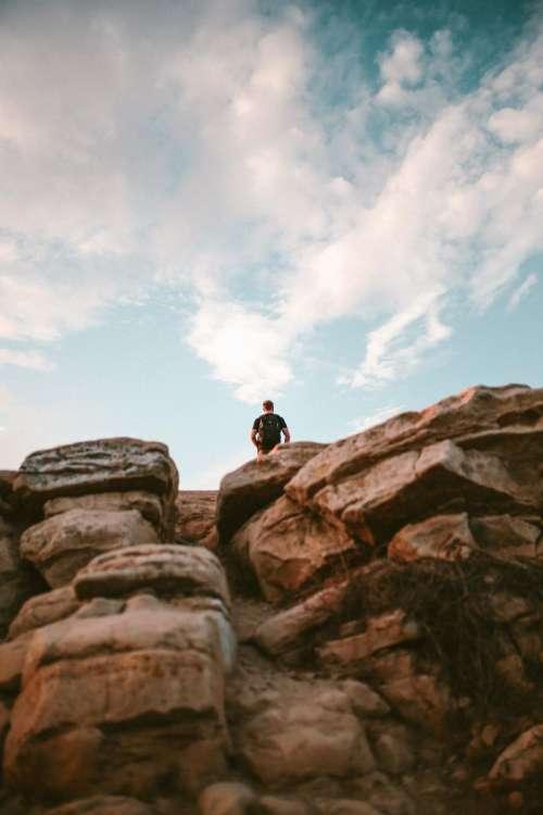 rock formation people man alone