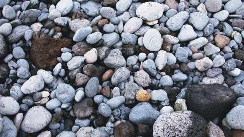 rocks pebbles beach sand ocean