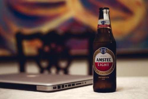 amstel brewery beverage laptop computer