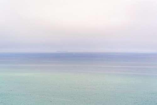 ocean sea water sky foggy