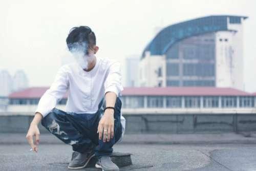 people guy alone sitting smoking