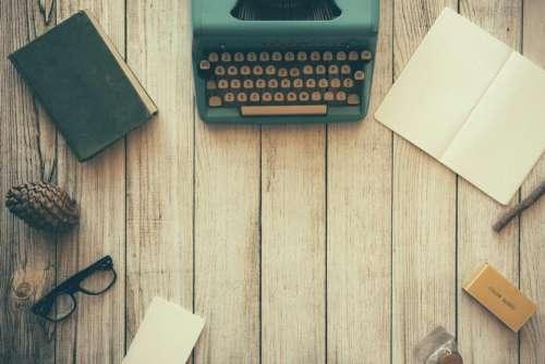 wood typewriter book pine cone eyeglasses
