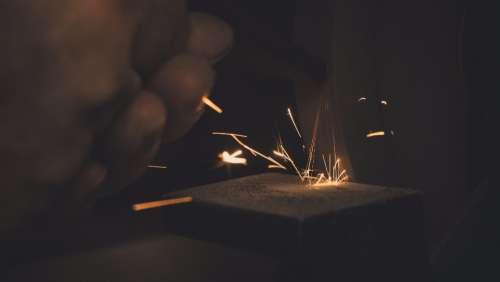 man working long exposure metal sparks
