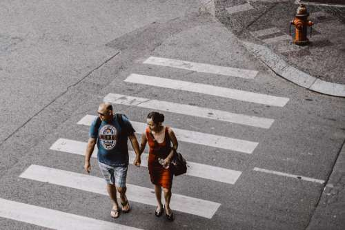 people man woman walking holding hands