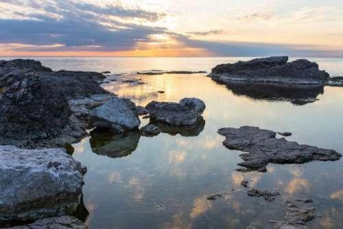 sea ocean water rock reflection