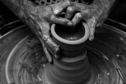 nails hands wrist clay pot