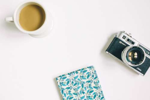 flat lay white table diary notebook