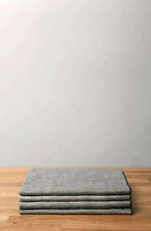 stack sheets minimal wood table