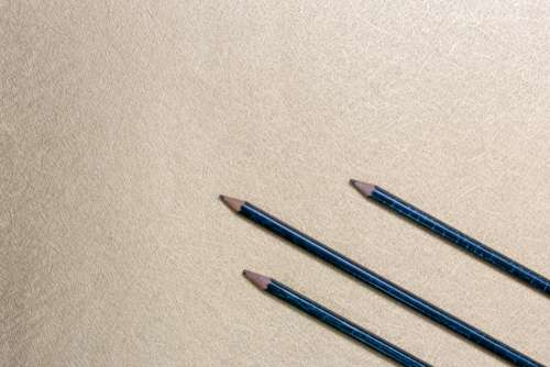pencils flat lay background gold shiny