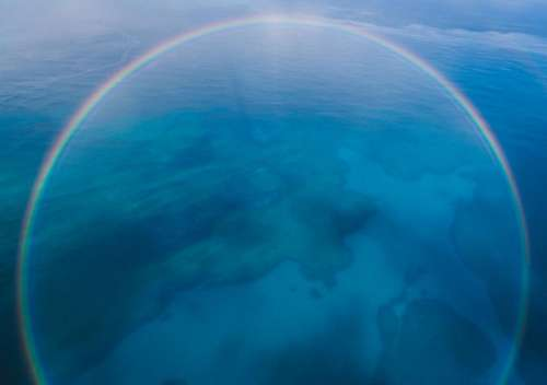 blue aerial view island rainbow