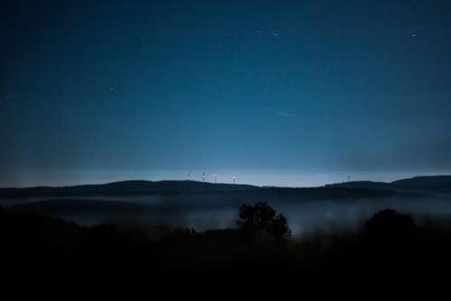 highland mountain night blue sky