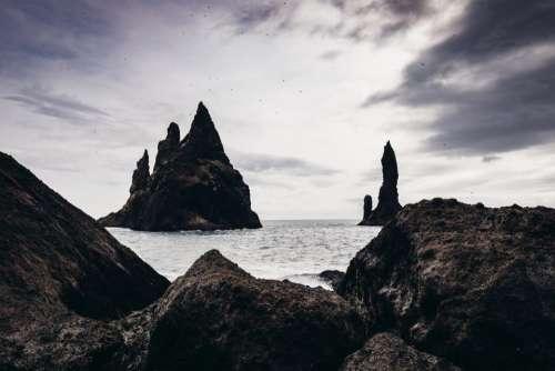 sea ocean water rocks cliff
