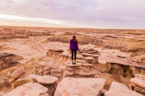 woman adventure desert rock sand
