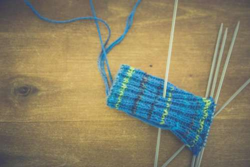blue yarn pouch knitting wooden