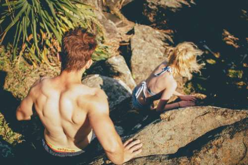 guy girl climbing hiking trekking