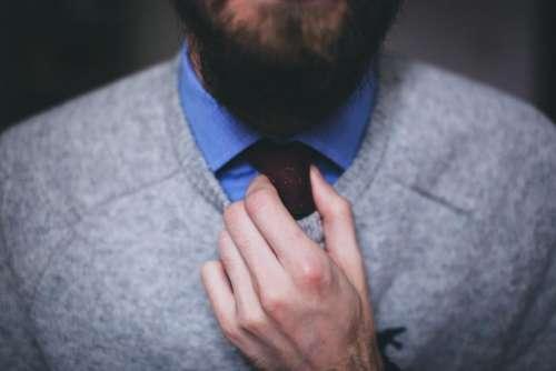 guy man tie sweater hands