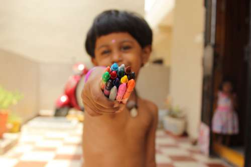 child colored crayons happy smile