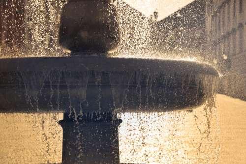 water fountain splash city close up