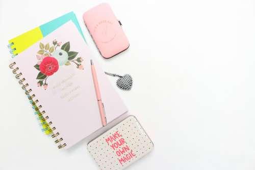 flatlay feminine desk notebooks boxes