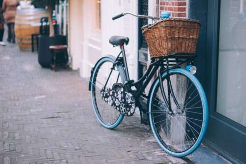 bicycle bike basket cobblestone sidewalk