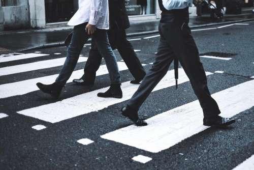 people walking men work city