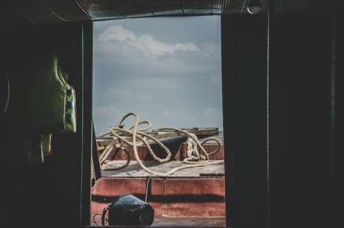 dark room rope boat clouds